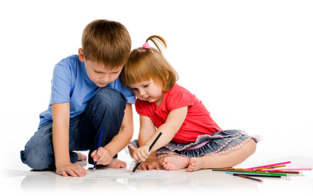 Girl and boy drawing.